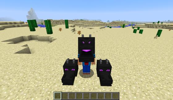 Deux têtes posées au sol et une tête posée sur un joueur.