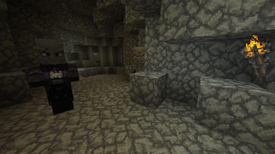Une grotte habitée par une sorcière et un squelette
