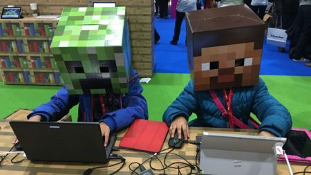 Two students build in Minecraft at BETT Conference