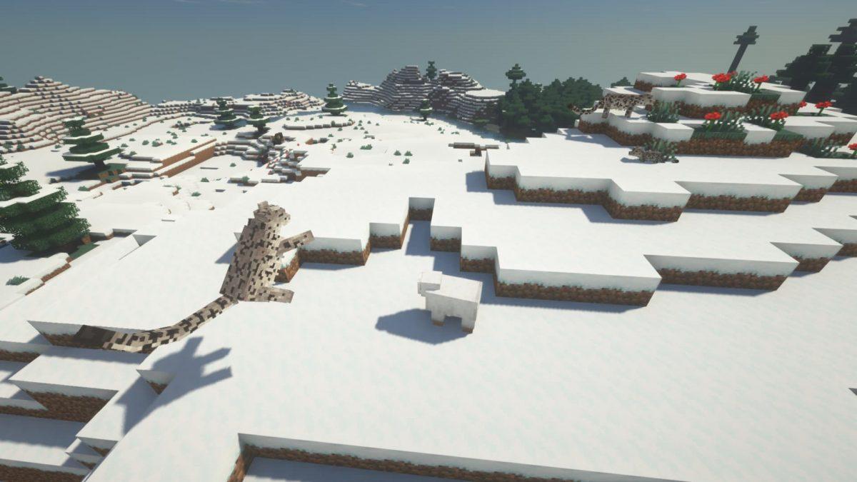 Un léopard des neiges se jette sur un mouton, tandis que deux autres se reposent en arrière-plan.